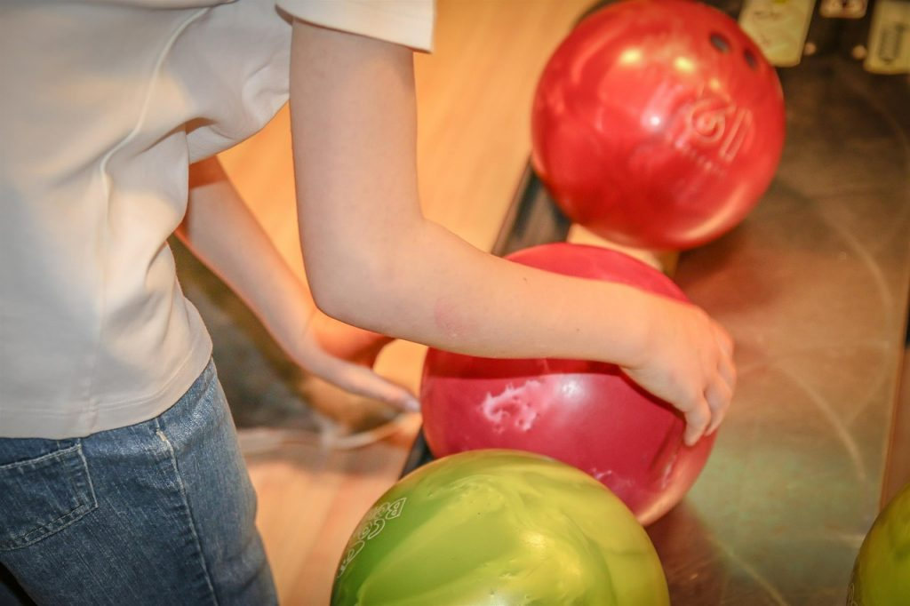 A Boy choosing a Bowling Ball - Post Picture for New bowling balls releases and Old Performers Comparison